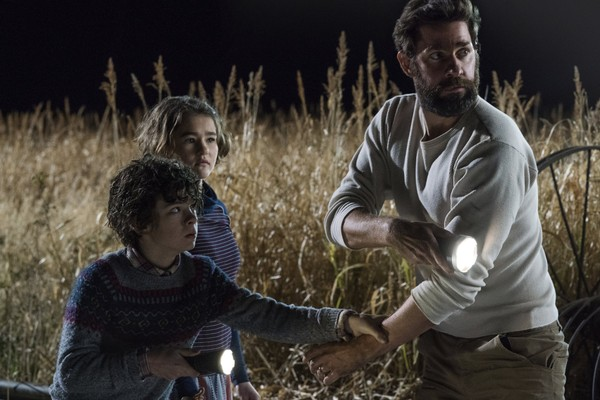 """This image shows Noah Jupe, from left, Millicent Simmonds and John Krasinski in a scene from """"A Quiet Place."""" (Jonny Cournoyer/Paramount Pictures via AP)"""