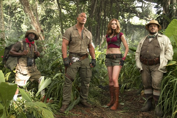 "FILE - This file image released by Sony Pictures shows Kevin Hart, from left, Dwayne Johnson, Karen Gillan and Jack Black in ""Jumanji: Welcome to the Jungle."""