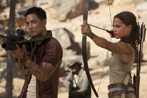 """This image released shows Daniel Wu, left, and Alicia Vikander in a scene from """"Tomb Raider.""""  (Ilze Kitshoff/Warner Bros. Pictures via AP, File)"""