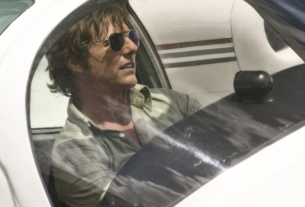 "This image released by Universal Pictures shows Tom Cruise as Barry Seal in a scene from, ""American Made."" (David James/Universal Pictures via AP)"