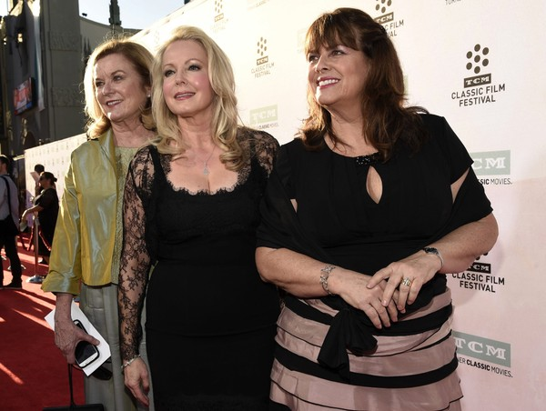 "FILE - In this March 26, 2015, file photo, Heather Menzies-Urich, from left, Kym Karath and Debbie Turner, cast members in the classic film ""The Sound of Music,"" pose together before a 50th anniversary screening of the film at the opening night gala of the 2015 TCM Classic Film Festival in Los Angeles."