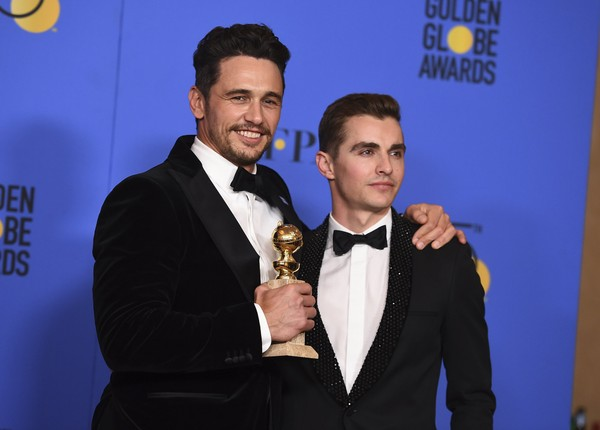 "James Franco, left, winner of the award for best performance by an actor in a motion picture - musical or comedy for ""The Disaster Artist,"" and Dave Franco pose in the press room at the 75th annual Golden Globe Awards at the Beverly Hilton Hotel on Sunday, Jan. 7, 2018, in Beverly Hills, Calif. (Photo by Jordan Strauss/Invision/AP, File)"