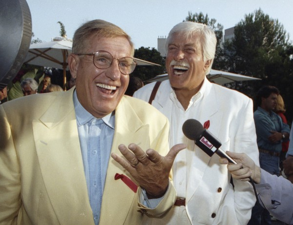In this Aug. 25, 1992 file photo, Jerry Van Dkyke, left, and his brother, Dick, laugh during a party in Los Angeles.