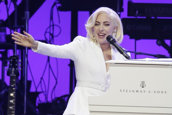 In this Oct. 21, 2017, photo, Lady Gaga performs during a hurricane relief concert in College Station, Texas. Lady Gaga will join the list of superstars with regularly scheduled shows in Las Vegas in 2018, when she kicks off a two-year residency in December. (AP Photo/LM Otero, file)
