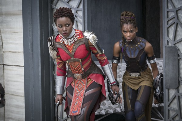 "This image released by Disney shows Lupita Nyong'o, left, and Letitia Wright in a scene from Marvel Studios' ""Black Panther."" (Matt Kennedy/Marvel Studios-Disney via AP)"