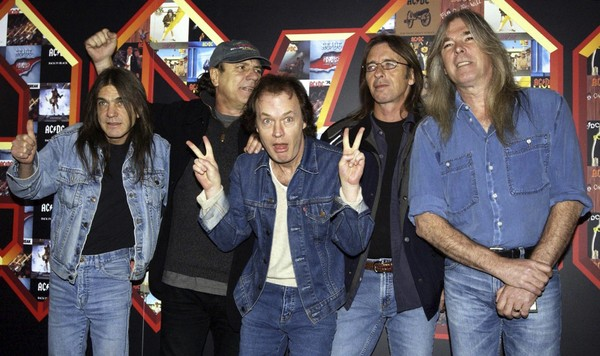 This 2003 file photo shows AC/DC, from left: Malcolm Young, Brian Johnson, Angus Young, Phil Rudd and Cliff Williams posing for photographers at the Apollo Hammersmith in London. The band announced, Saturday, Nov. 18, 2017, that 64-year-old Malcolm Young has died. (Yui Mok/PA via AP, File)
