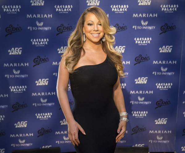 In this Monday, April 27, 2015, file photo, Mariah Carey poses for a photo at her Official Welcome to Caesars Palace in Las Vegas.