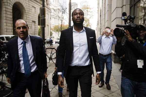 Rapper Meek Mill, center, accompanied by his defense attorney Brian Mcmonagle arrives at the criminal justice center in Philadelphia, Monday, Nov. 6, 2017. A Philadelphia judge sentenced Mill to 2 to 4 years in state prison for violating probation in a nearly decade-old gun and drug case. (AP Photo/Matt Rourke)
