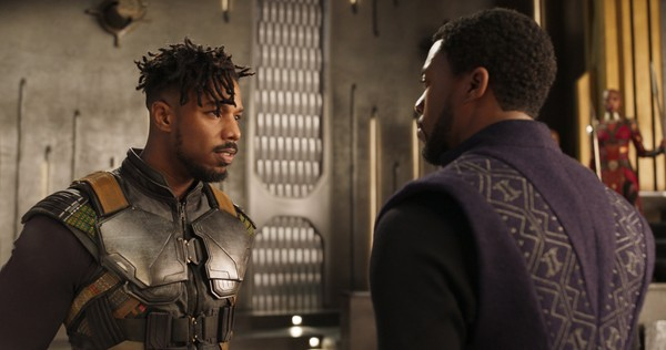 "This image released by Disney shows Michael B. Jordan, left, and Chadwick Boseman in a scene from ""Black Panther."" (Marvel Studios-Disney via AP)"