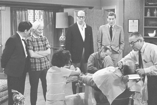 In this April 11, 1963, file photo, standing from left, Morey Amsterdam, Rose Marie, and Richard Deacon, and Dick Van Dyke, right, gather around Carl Reiner, in barber chair during a rehearsal of an episode for the