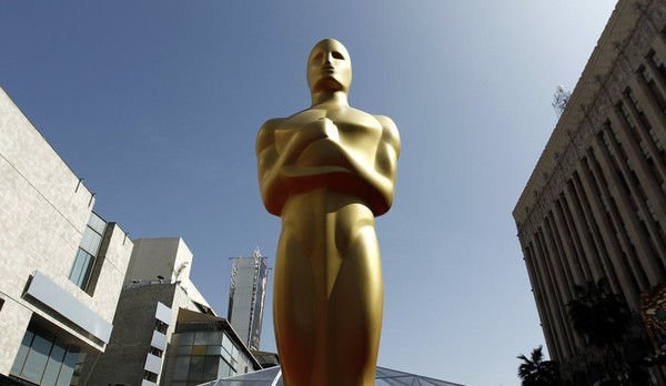 FILE - This Feb. 26, 2012 file photo, shows an Oscar statue on the red carpet before the 84th Academy Awards in Los Angeles. The 90th annual Academy Awards are set for March 4, 2018. (AP Photo/Matt Sayles, File)