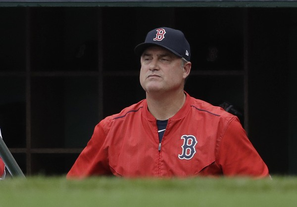 In this Oct. 8, 2017, file photo, Boston Red Sox manager John Farrell watches from the dugout during the second inning in Game 3 of baseball's American League Division Series against the Houston Astros, in Boston. The Red Sox announced Wednesday, Oct. 11, 2017, that Farrell will not return as the club's manager for the 2018 season. (AP Photo/Charles Krupa, File)