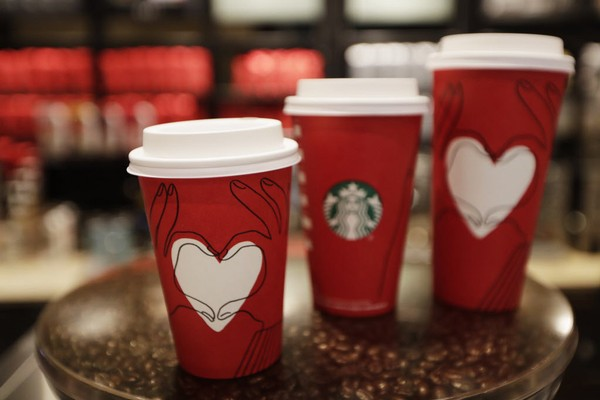 If you're starting your day with a sugary coffee drink, stop immediately, says registered dietitian Molly Kimball. Instead, tweak your coffee and turn it into a healthier drink. (AP Photo/Hiro Komae)