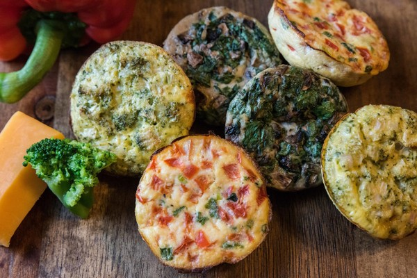 Assorted egg white bites inspired by those served at many Starbucks coffee shops, including broccoli and cheddar; spinach, mushroom and Gruyere; and red pepper and tomato. (Photo by Teddie Taylor)