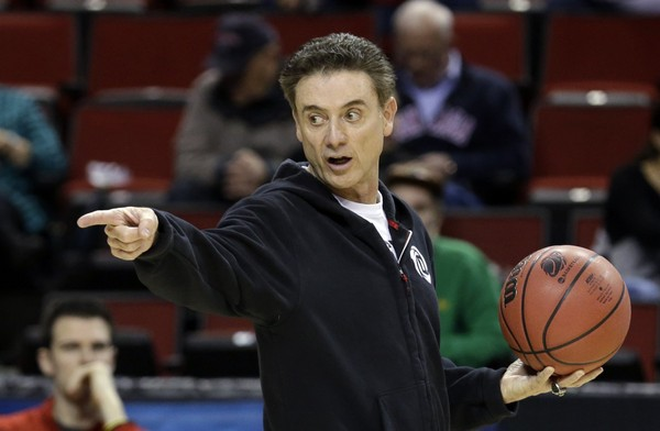 Rick Pitino directs the Louisville men's basketball team during practice for an NCAA college basketball tournament second-round game in Seattle, Thursday, March 19, 2015. (AP Photo/Elaine Thompson)