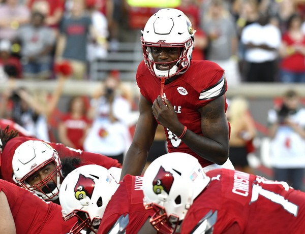 Louisville quarterback Lamar Jackson calls out at the line of scrimmage during the first quarter of an NCAA college football game against Charlotte, Thursday, Sep. 1, 2016, in Louisville, Ky. (AP Photo/Timothy D. Easley)