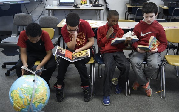 The fifth grade class at Delaware School in Syracuse read together in this March 1, 2017 file photo. Dennis Nett | dnett@syracuse.com