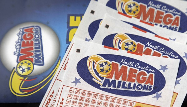 Mega Millions lottery tickets rest on a counter, in this file photo.