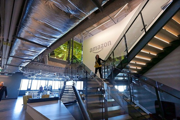 An Amazon worker walks down steps in a company office before an event announcing several new Amazon products by the company Sept. 27 in Seattle.
