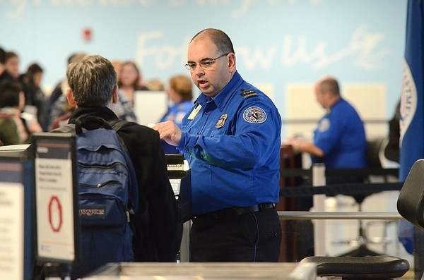 A TSA officer checks boarding passengers at Syracuse Hancock International Airport on Nov. 23, 2016. New security procedures for carry-on electronic items are being implemented at Syracuse and other Upstate New York airports.