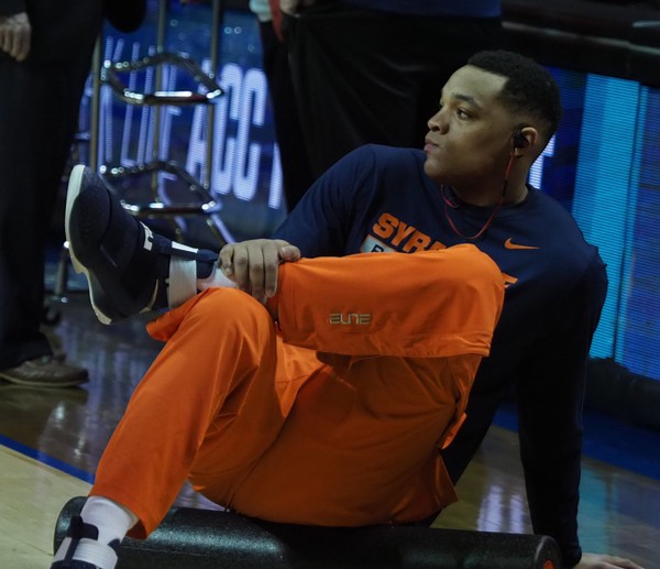 Dajuan Coleman stretches. Syracuse players warm up before their game against Miami in the second round of the 2017 New York Life ACC Tournament on Wednesday March 8, 2017 in the Barclays Center in Brooklyn.  (Stephen D. Cannerelli   scannerelli@syracuse.com)