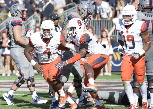 Syracuse football linebackers Zaire Franklin (left) and Parris Bennett (middle) are two of the team's six captains this season.
