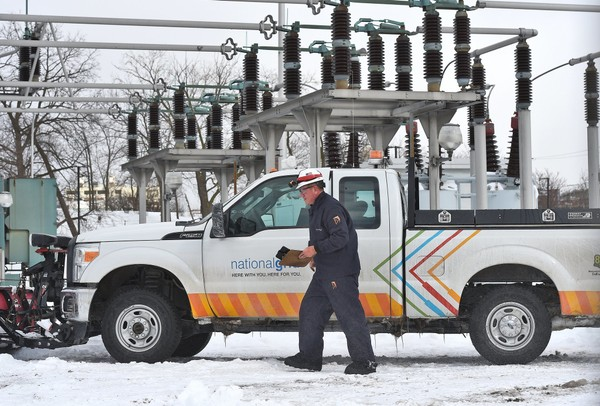 A National Grid worker gets out of his truck at the the National Grid Temple Station at 423 Oneida St. in Syracuse, on Thursday afternoon, March 16, 2017.