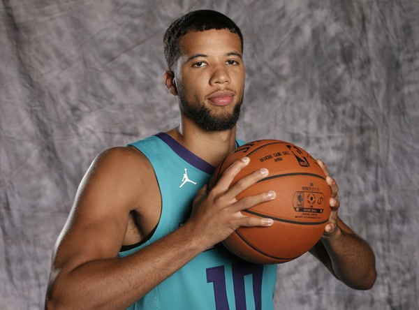Charlotte Hornets' Michael Carter-Williams poses for a photo during the NBA basketball team's media day in Charlotte, N.C., Monday, Sept. 25, 2017. (AP Photo/Chuck Burton)