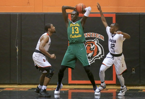 Majur Majak (No. 13) grabs a rebound for Roselle Catholic last season. Syracuse is reportedly among the schools interested in recruiting the 7-1 center from Sudan.