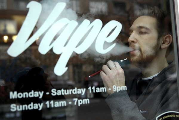 A man uses an electronic cigarette in Chicago Vape store in this file photo.