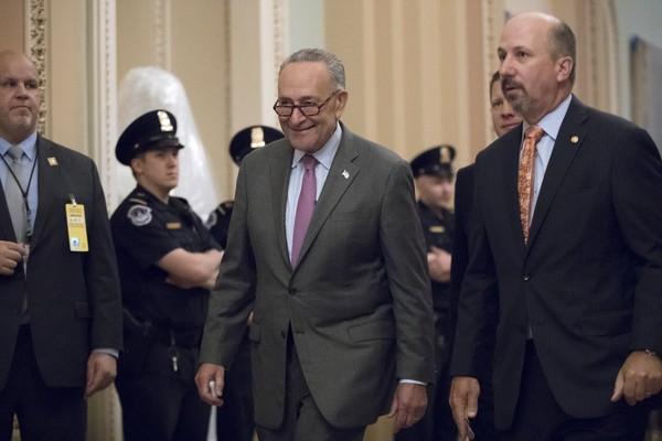 Senate Minority Leader Chuck Schumer, D-N.Y., smiles as he arrives at the Senate as GOP  lawmakers were having lunch with President Donald Trump in Washington, Tuesday, Oct. 24, 2017. (AP Photo/J. Scott Applewhite)