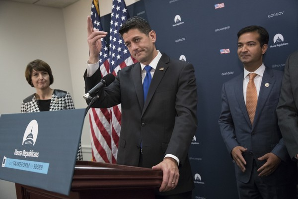 Speaker of the House Paul Ryan, R-Wis., flanked by Rep. Cathy McMorris Rodgers, R-Wash., left, and Rep. Carlos Curbelo, R-Fla., a member of the House Ways and Means Committee, talks about advancing the GOP agenda for tax reform, during a news conference on Capitol Hill in Washington, Tuesday, Oct. 24, 2017. (AP Photo/J. Scott Applewhite)