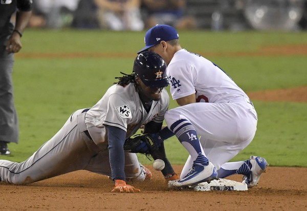 Houston Astros Cameron Maybin left steals second past Los Angeles Dodgers Austin Barnes during the 11th inning of Game 2 of baseball's World Series Wednesday Oct. 25 2017 in Los Angeles