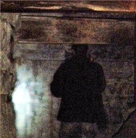 The Ghost Finders Association of Central New York says this photo taken July 30, 2009 at Split Rock Quarry shows proof of ghosts. Stephan Morasco, whose back is to the camera, says he felt tingling and numbness, then he asked someone to take a photo.