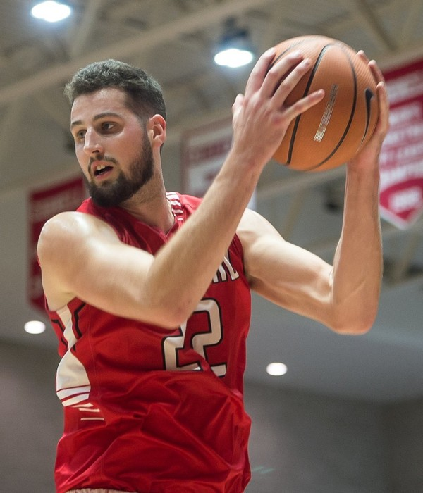Cortland SUNY Zach Lydon snags a rebound from Cornell during the pre-season exhibition game at the Newman Arena at Cornell November 4, 2017. N. Scott Trimble | strimble@syracuse.com
