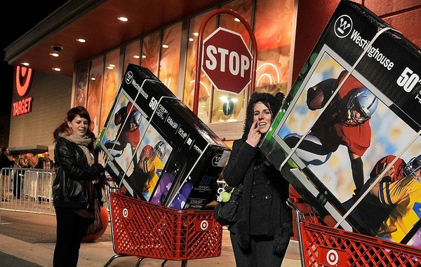 Brenda McMahon, right, and her sister, Katie McMahon, both from Fairmount, exit the Target store in Fairmount on Thanksgiving in a file photo.
