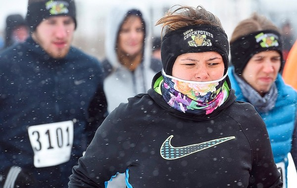 In this February file photo, runners in the 7th Annual Couch Potato 5K wear whatever it takes to keep warm.  Nearly 500 runners participated in the run in freezing temperatures and a 20 mph wind.