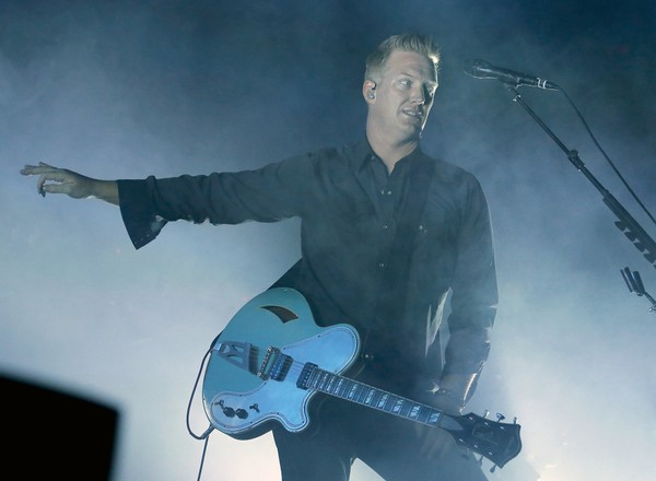 Josh Homme of Queens of the Stone Age performs at the Arizona State Fair on Thursday, Oct. 30, 2014, in Phoenix, Arizona.