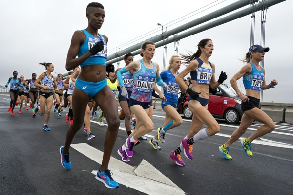 Elite women runners cross the Verrazano-Narrows Bridge during the New York City Marathon on Sunday, Nov. 5, 2017, in New York. Winner of the 2017 women's division Shalane Flanagan is in background at far left. (AP Photo/Craig Ruttle)