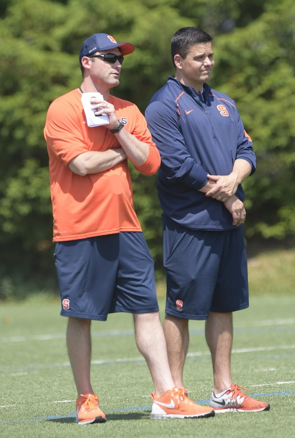 Syracuse football defensive coordinator Brian Ward (right) has been nominated for the Broyles Award, which honors the top assistant coaches in college football.