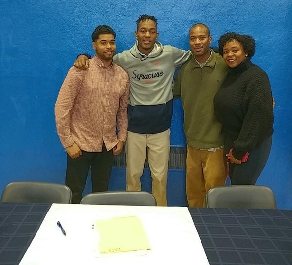 Syracuse recruit Jalen Carey (second from left) signed his letter of intent on Thursday in a ceremony at his high school. On the left is Carey's AAU coach Kiela Brevard. On the right are Carey's parents; John and Tawana.