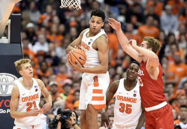 Syracuse forward Matthew Moyer grabs one of his 10 rebounds in the Orange's win over Cornell on Friday at the Carrier Dome.