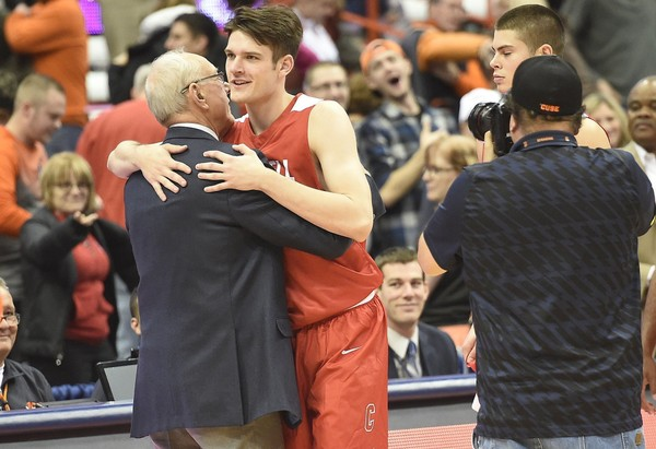 Syracuse coach Jim Boeheim embraces his son Jimmy, who plays for Cornell, after the game at the Carrier Dome, Nov. 10, 2017. Dennis Nett | dnett@syracuse.com