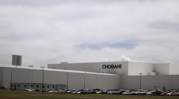 FILE - This June 10, 2013 file photo shows the Chobani plant near Twin Falls, Idaho. Greek yogurt giant Chobani announced Thursday, Nov. 9, 2017 a $20 million expansion of its world's largest yogurt plant in south-central Idaho to serve as the company's global research and development center.