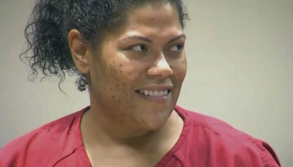 In this June 8, 2017 frame from video provided by 13WHAM, Rochester City Court Judge Leticia Astacio, looks in the direction of her attorney during an appearance in court.