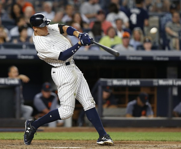 In this July 31, 2017, photo, New York Yankees' Aaron Judge hits a solo home run during the fifth inning of a baseball game against the Detroit Tigers at Yankee Stadium in New York. (AP Photo/Kathy Willens, File)