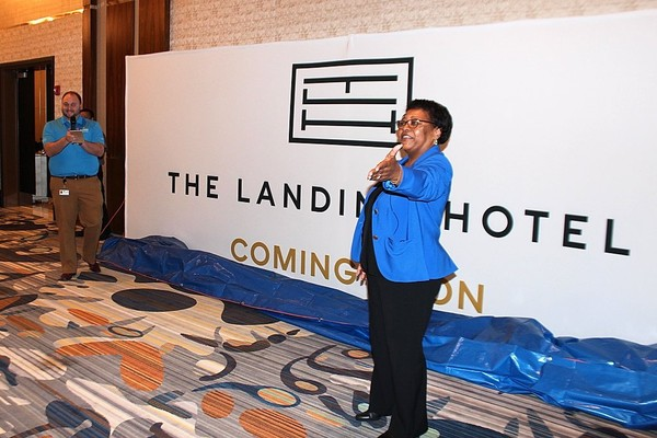 "Mary Cheeks, general manager at Rivers Casino & Resort in Schenectady, unveils the logo for the property's ""The Landing Hotel,"" which opened in July."