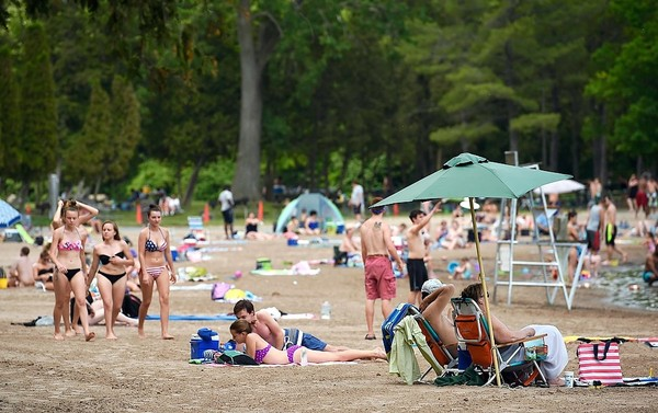 The beach at Green Lakes State Park in Manlius attracted a large crowd when temperatures rose to 90 degrees on June 12.