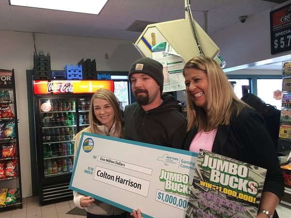 Meagan Harrison, left, and her husband Colton Harrison with the New York State Lottery's Yolanda Vega at The Depot in Jamesville. Colton Harrison won $1 million on a scratch-off ticket.
