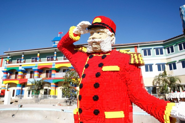 File photo of a Lego Bellhop greets guests in front of Legoland Hotel at Legoland California Resort.